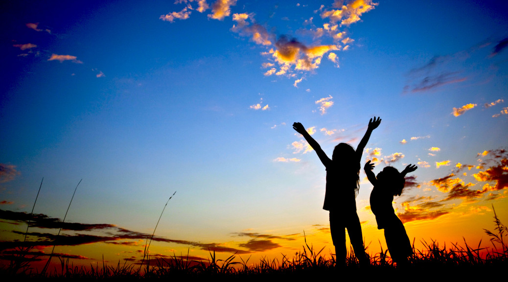 Silhouette of two happy children with their hands raised in worship. Outside. Sunset. Additional themes include praise and worship, kids, celebration, joy, peace, Christianity, religious, balance, wonder, awe, singing, happiness, togetherness, friends, friendship, love, faith, salvation, gratitude, attitude, hope, nature, and outdoors. Children are elementary aged and are unrecognizable. Caucasian models.