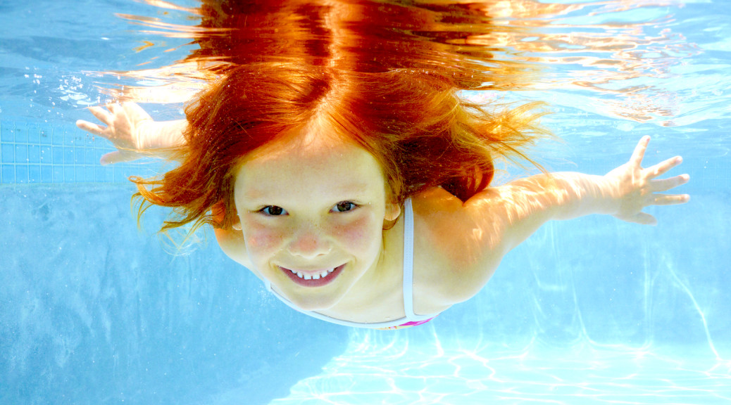 Portrait of a young girl diving underwater